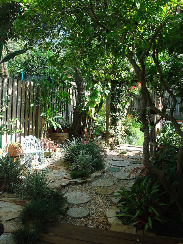 West side yard; pathway and flagstone combined for hardscape accent to shade loving plants.