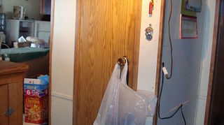 pantry problem or problem pantry, closet, shelving ideas, THis is the front with the door closed There are only a couple of inches of wall on each side of the door The pantry is a good 18 or so wider at the back than you see here in the front