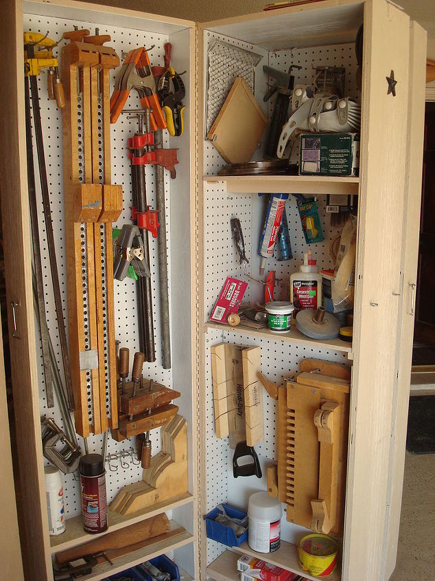 i finally got tired of having all my tools scattered all over my garage and decided, diy, how to, shelving ideas, storage ideas, close up of one side and the center unit all three are hinged with piano hinge on back and caster on the base for moving around