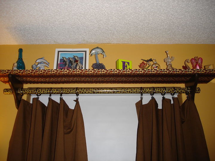 """Custom window treatments courtesy ME! covered a piece of MDF in leopard print fabric and placed on brackets w/a whole cut through and a dowel! We even sewed the panels ourselves (she helped) this is a lost space that now holds """"treasures"""" not to be handled too much!"""