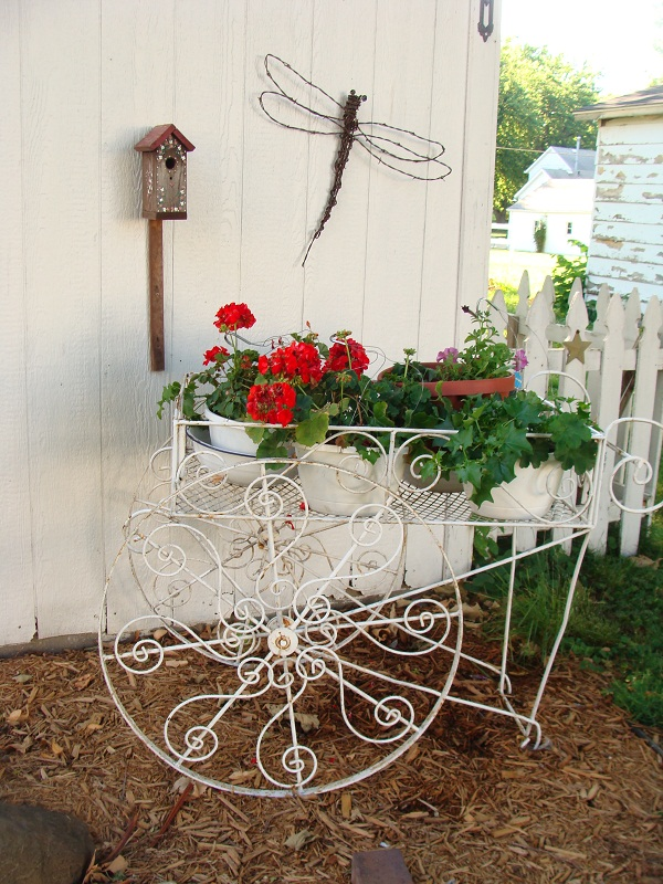 q how would you go about restoring the finish on this old metal flower cart paint, flowers, gardening, painted furniture, My vintage flower cart