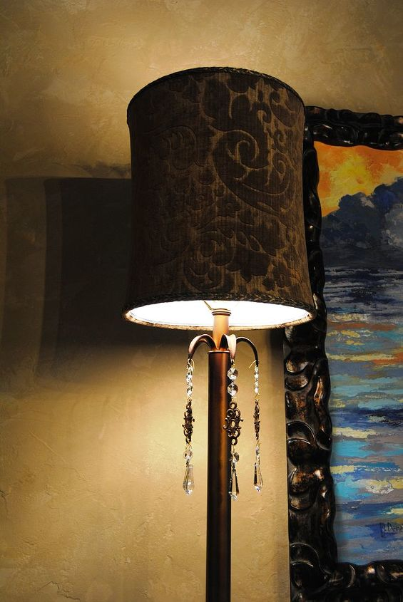 I contrasted the lamps to the chandelier and fabrics