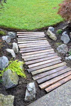 make a pallet wood walkway for your garden, diy, flowers, gardening, landscape, pallet, repurposing upcycling, Placing the planks in a slight curve as well as random alignment made for a slightly more interesting take