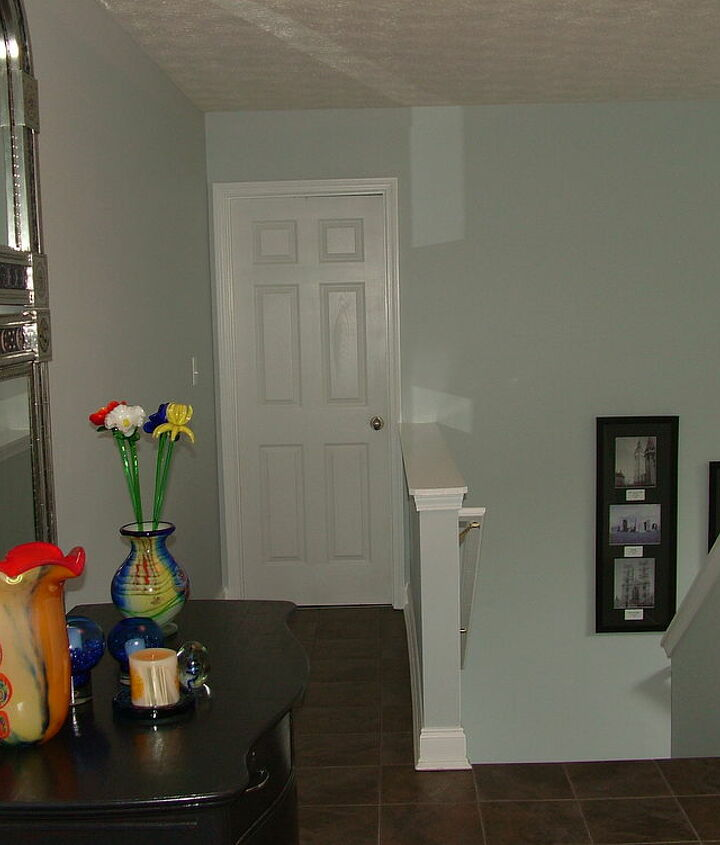 AFTER- Tile hallway- easy upkeep and no wear and tear of traffic! (from there the tile and wood stairs begin)