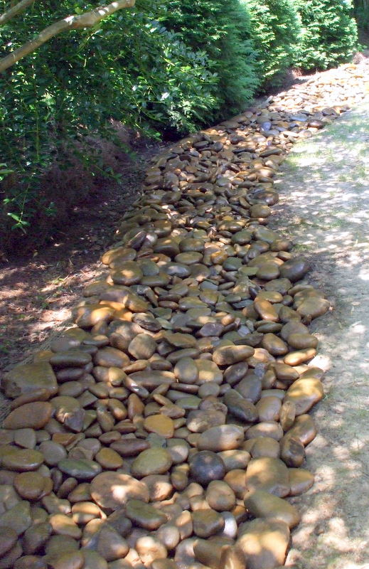 dry creek beds can be a viable and attractive alternative for drainage issues on this, gardening, landscape