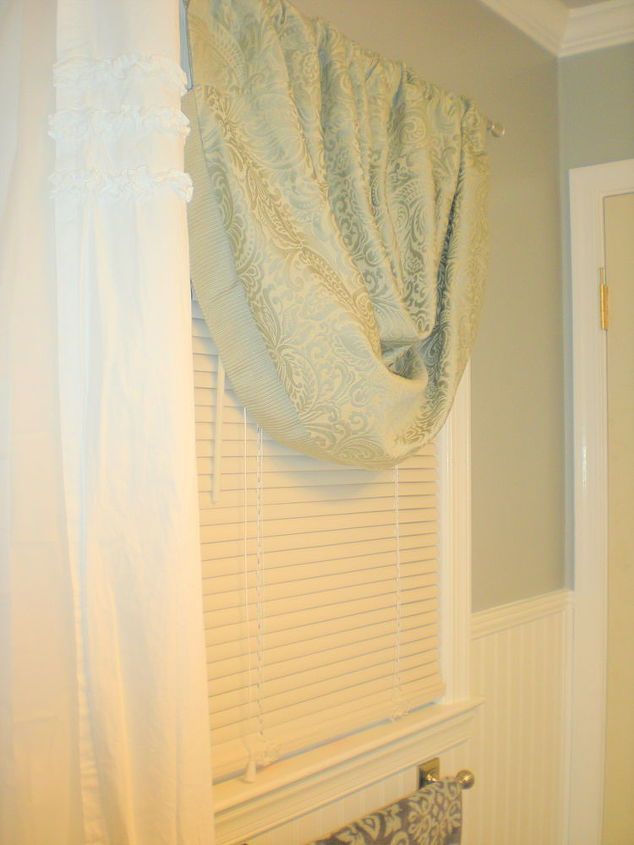 Simple blinds and a sliver-grey valance is all the little window needed.