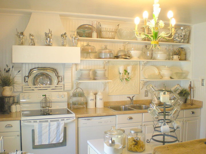 Architectural salvage, finds from junk stores and antiques shops, plus off the shelf items from a few Big Box hardware stores come together to create a warm and functional kitchen.