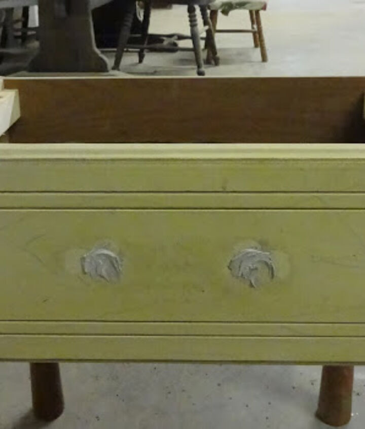 An old drawer I had left over from a dresser turned media cabinet.  I filled the holes so I could use different hardware.