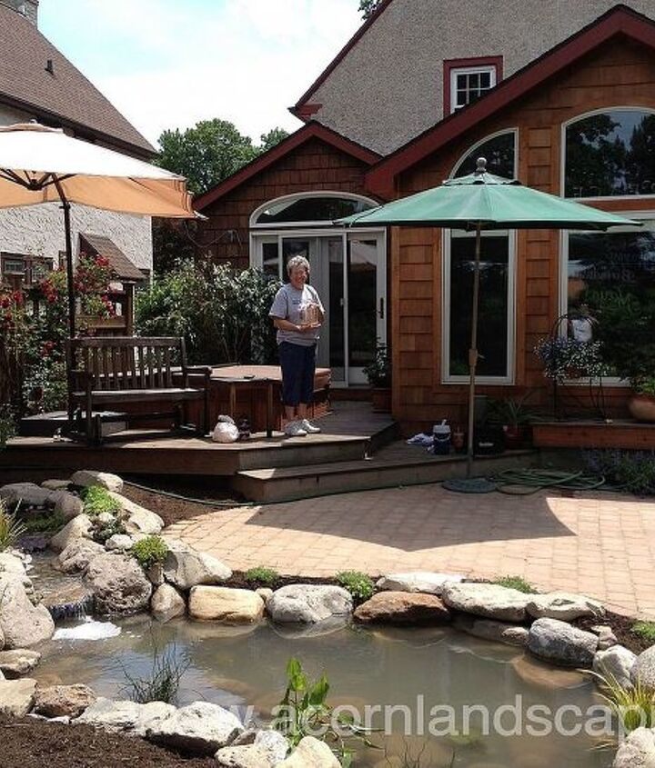 """Now there's a happy home owner! Project finished right on schedule. While placing the plants in the pond, we remove them from their containers and actually """"plant"""" the plants in the pond. This helps create the natural look that we want"""
