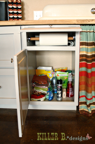 """This 21"""" cabinet now houses two pull-out trash cans as well as the paper towel storage above"""