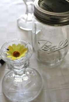 redneck wine glasses an inexpensive gift idea, crafts, repurposing upcycling, We used fabric flowers from Dollar Tree to give the base candlestick holder also from Dollar Tree a little more personality Glass glue from Michael s holds the jar to the base
