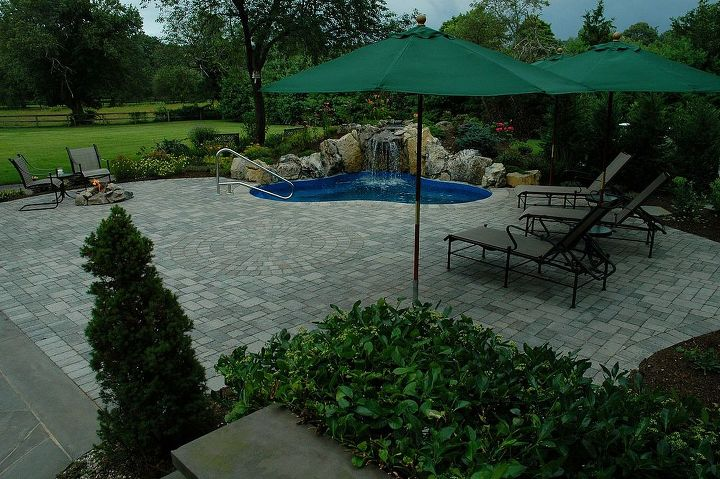 Spool with a paver patio, embedded umbrellas, and a gas fire pit. Built on Long Island by www.longislandhottub.com  See more creative photos at http://www.longislandhottub.com/decks-and-patios-portfolio.php