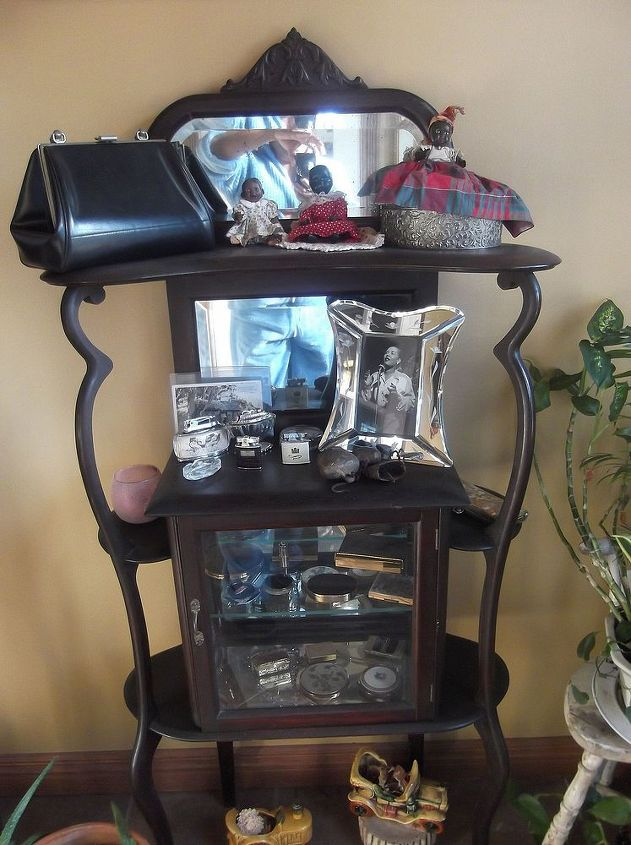 The antique etagere holds all her cute collectibles.  Love the Bille Holiday picture.