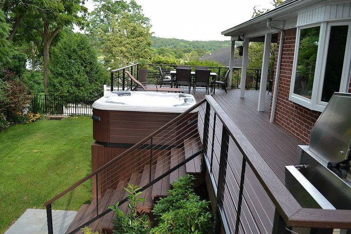 Maintenance Free Decking: Hot tub's PCV boards, Trex decking and stainless steel railing are ultra-low-maintenance.
