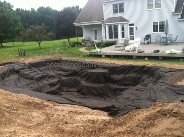 Landscape fabric installed. This will help protect the rubber liner that will go over it.