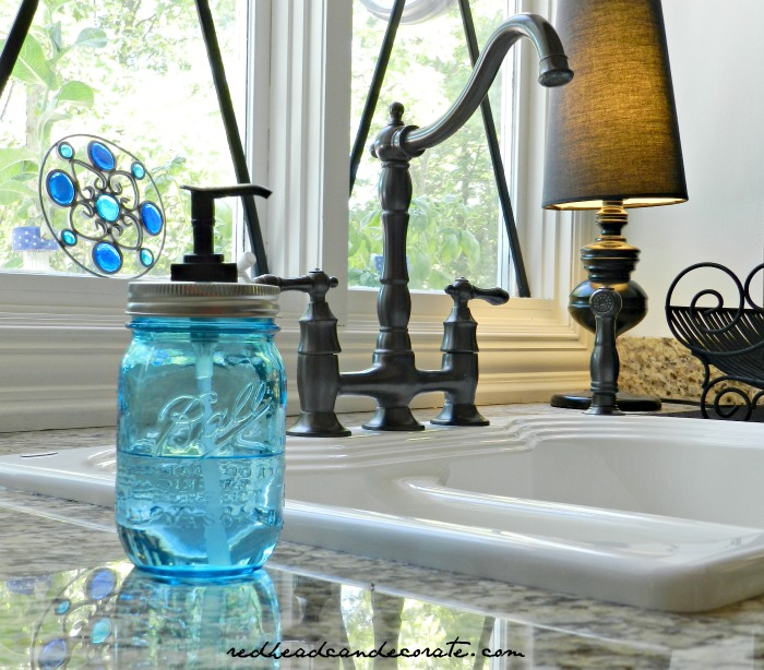 ball jar hand soap dispenser, repurposing upcycling, I used clear antibacterial soap What s really nice is that I don t have to fill it as often It s big so the soap lasts