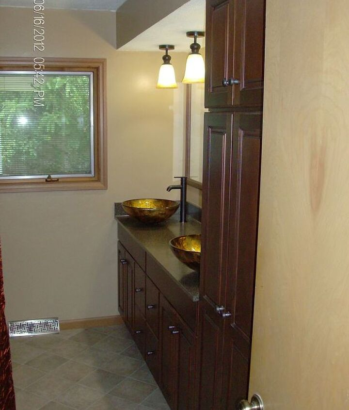 New cabinets,custom laminate top,vessel sinks,faucets,and custom framed mirrors.
