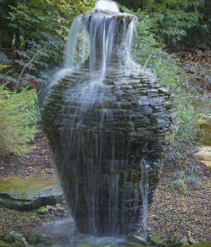 A stacked slate fountain urn becomes architecture in the garden.
