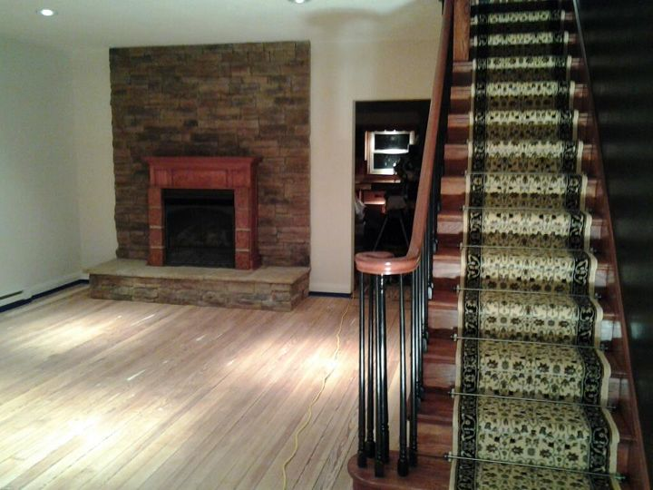 During # 1 Floors ready to stain. Fire place completed, stairs stained, painted and finished with carpet - see pics below)