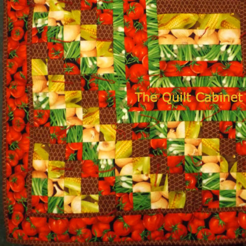 Her is a close-up of The Produce Quilt...My way of growing veggies...notice the Chicken Wire...it keeps the critters from eating the harvest...