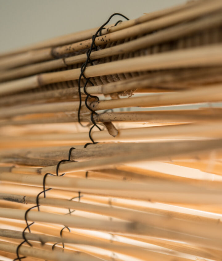 diy bamboo blinds out of outdoor fencing, diy, home decor, repurposing upcycling, window treatments, windows, Using wire from the bamboo shades were you cut start making the folds and using the wire to keep it uniform