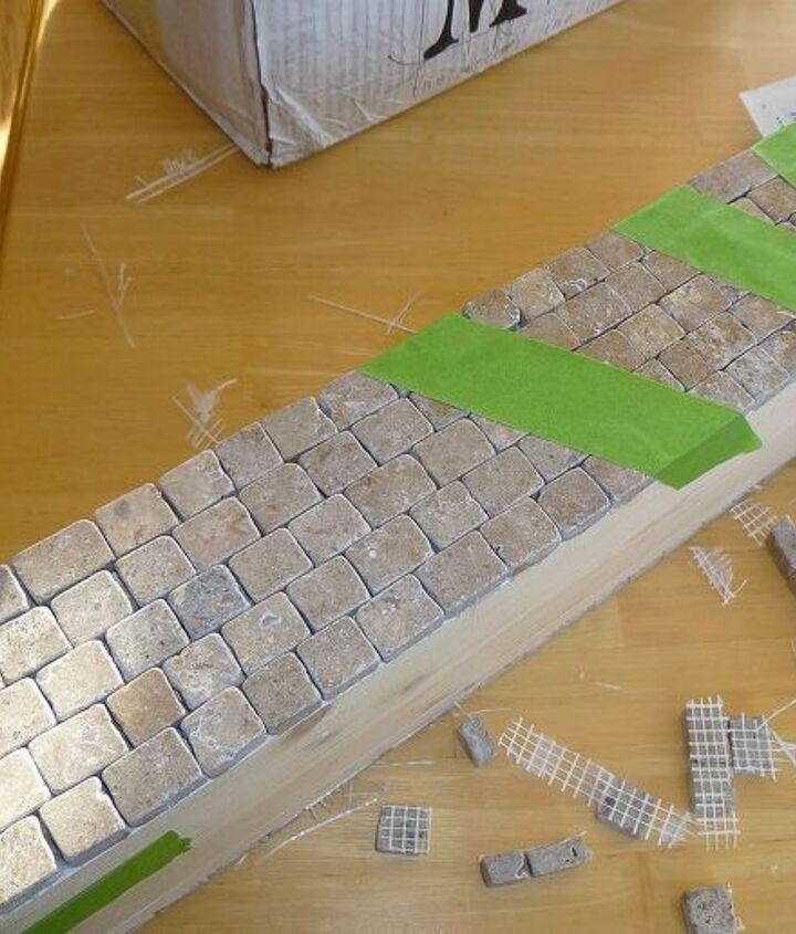 Added rows at a time, taking tile off the mesh as needed to fit.  Attached the tile with silicon adhesive.