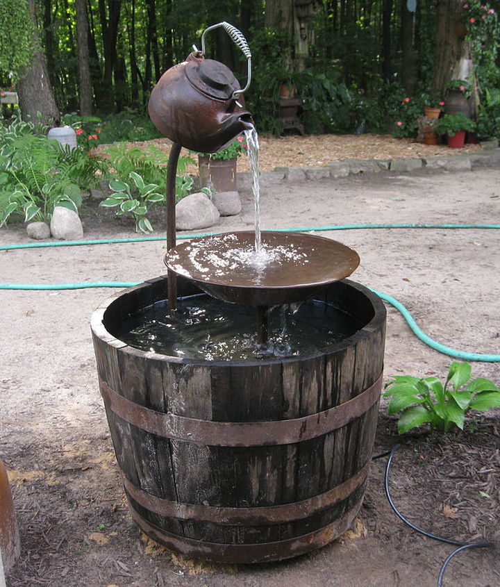 Last year we poured a concrete base that the whiskey barrel sits on so it doesn't sink into the dirt.