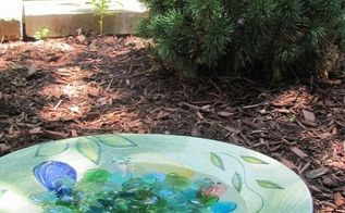 how to make a birdbath from a large salad plate, gardening, How it looks in front of the little frog pond We used to have fish in there but now it s just frogs I like frogs so it s okay