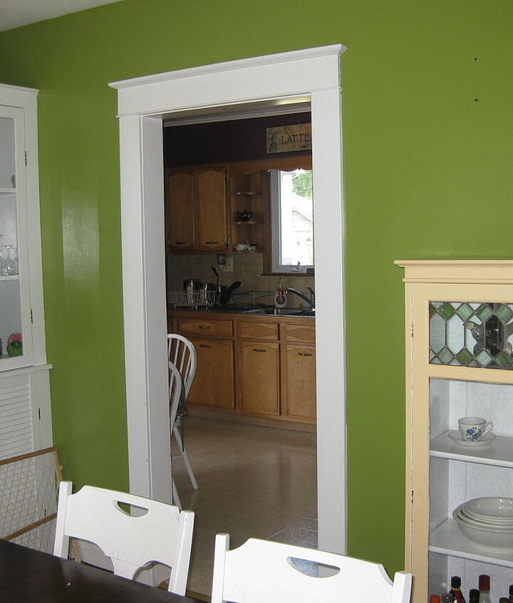 What color would you paint this cream china cabinet?  She's thinking cobalt/orange curtains.