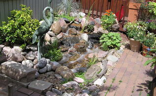 pondless waterfalls work well when space is at a premium, ponds water features, urban living, A small pondless waterfalls livens up this Denver Colorado backyard The yard is small and narrow behind a century old Victorian home but has enough room to add a beautiful water feature