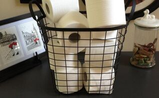 pretty toilet paper storage solutions, bathroom ideas, cleaning tips, organizing, I found this basket at Goodwill for 25 cents I touched it up with some black spray paint Perfection