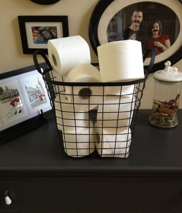 I found this basket at Goodwill for 25 cents. I touched it up with some black spray paint. Perfection.