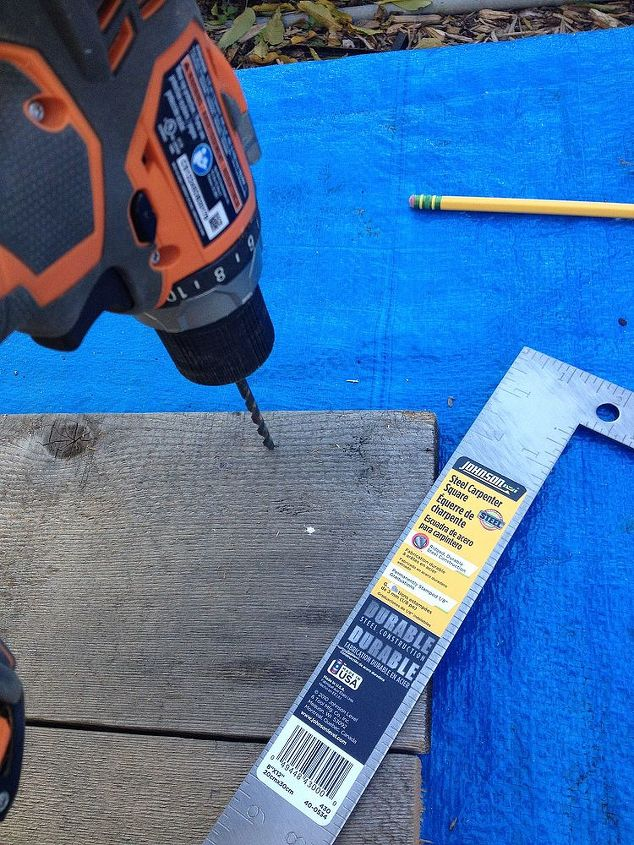 Drill holes to hang boards by and sand boards.