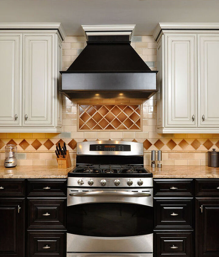Contrasting Artesia style cabinetry: Oyster wall cabinets with a caramel glaze and Truffle base cabinets; high-end crackle glass backsplash tiles & LED under cabinet lights