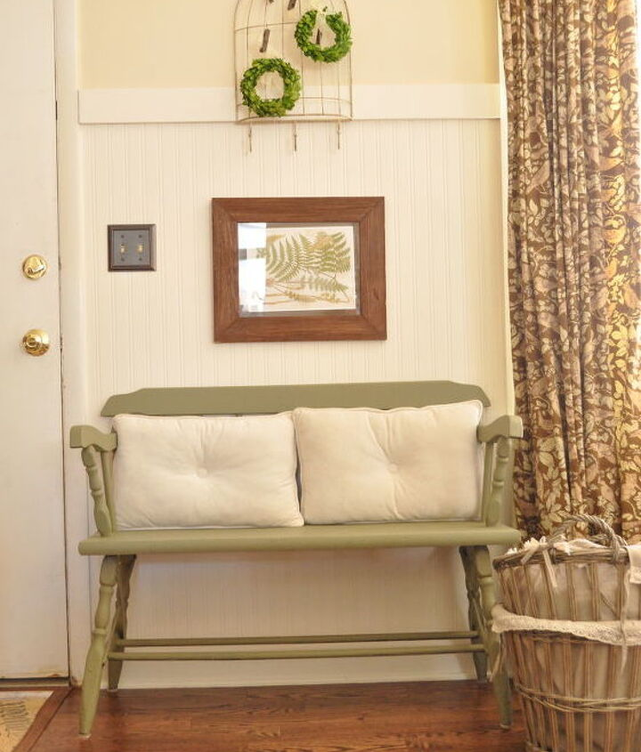 Bench area with boards and beadboard wall paper