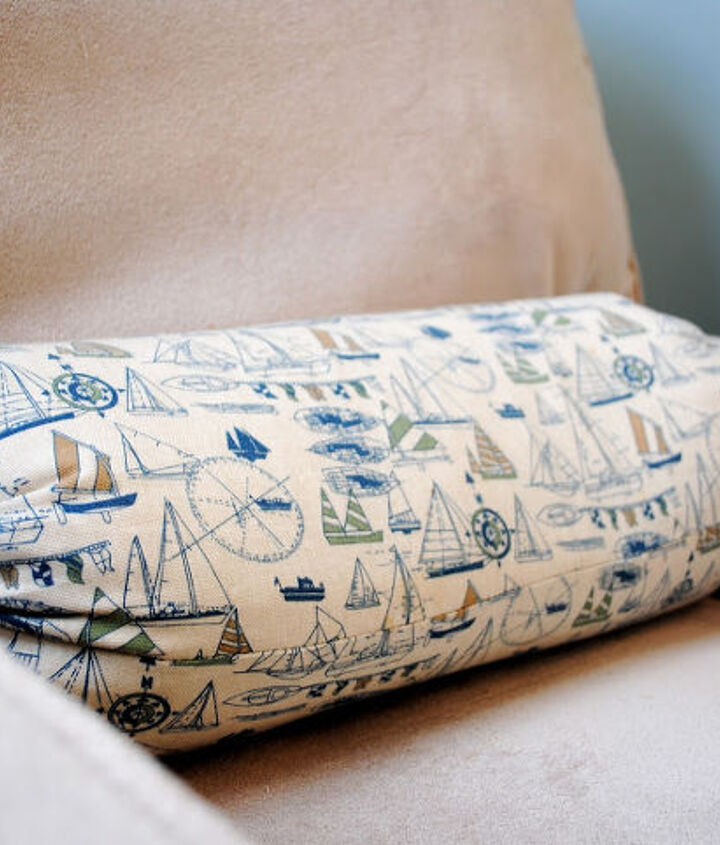 Pillows such as this sailboat bolster add to the look without going 'overboard'.  {wink}