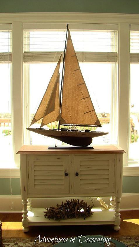 Of course, I just *had* to add an oversized, vintage boat!  I also painted the table Annie Sloane's Old White chalk paint, followed by a bit of distressing.
