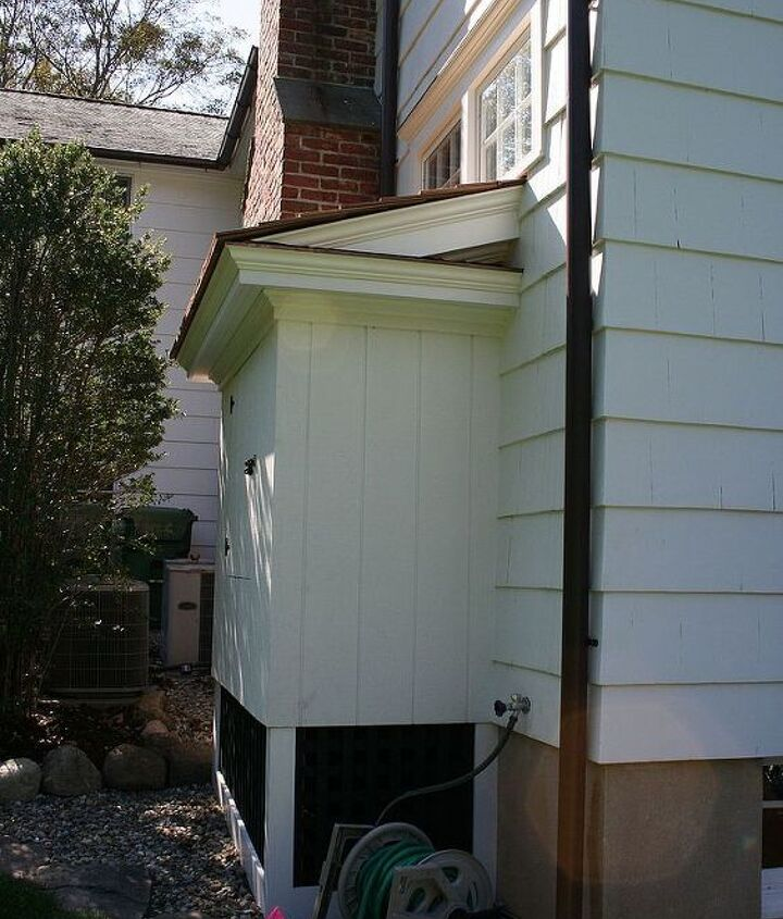 Side view of insulated wood shed for logs - Titus Built, LLC