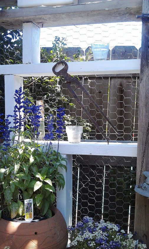 I was lucky to find an unwanted roll of chicken wire at the ranch to use behind my shelving area to keep items from falling through the back. That is an old hoof nipper I used to use to trim my horses hooves.