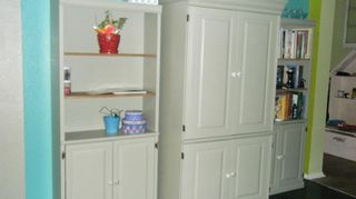 q dining room help do you like this color at first she didn t but it s growing on, home decor, painting, This is the armoire turned craft closet I painted it the gray of the accent wall