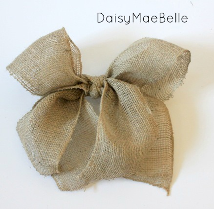 Tie another piece of burlap in a knot over the twine. You have the perfect burlap bow!