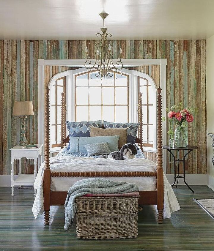 Blue and aqua bedding plays off the hues in the weathered wood walls and floor. A pair of mismatched nightstands brings the room's formal four-poster bed down to earth.  > http://wayfair.ly/1cmavVj