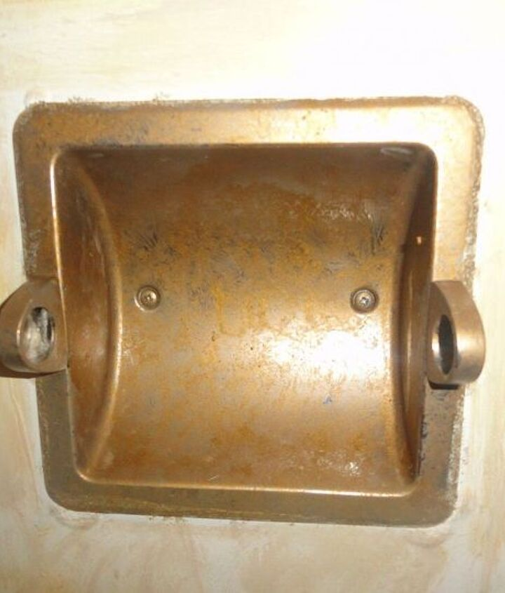 toilet paper holder i used metallic gold paint to distress it.