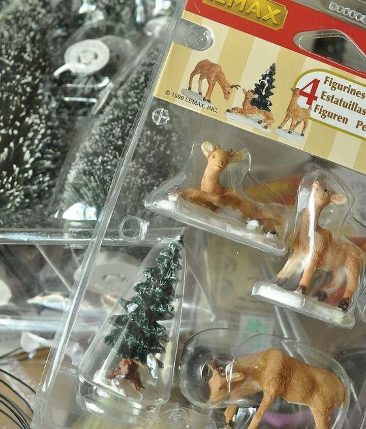 Purchase some inexpensive figures and mini trees found at most craft stores and even the dollar store.