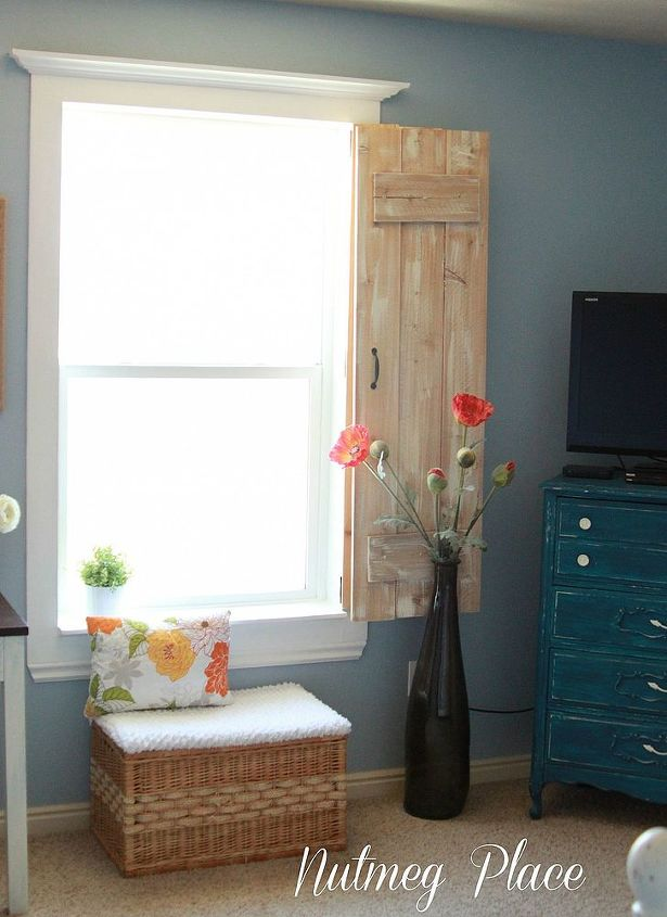 Window molding and rustic shutter.