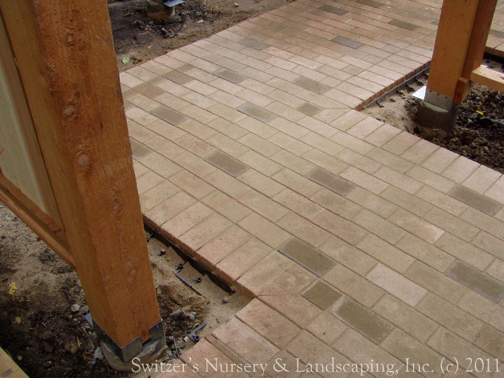 Close up of the clay paver path as it zig-zags through the pergola.  The running bond pattern of the paving is carried all the way through... The clay pavers are beautiful and are from Pine Hall.