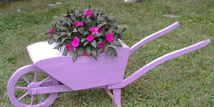 hello here is the picture of my wheelbarrow that i found in someone s junk, gardening, repurposing upcycling
