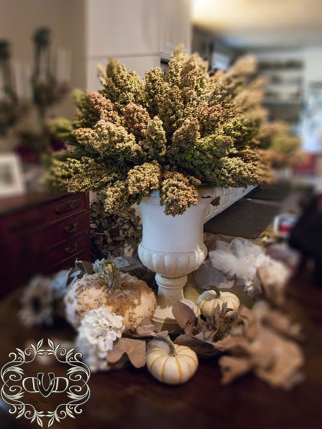 Surrounded in my natural hand made swag...this topiary is the perfect table top decoration for my small round table.
