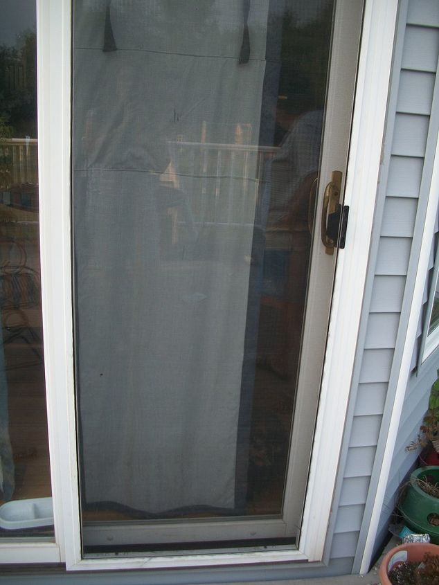 Our newly fixed screen door looking like new.  The kitties are older now and not as destructive, so hopefully it will stay that way.