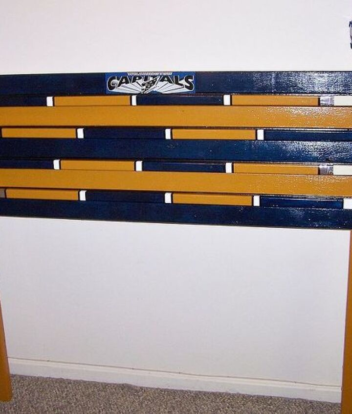 Just used 2x4's & 2x3's. Bought the hockey sticks at the Sports Authority. Used enamel paint & auto detailing tape.